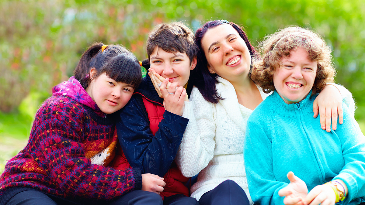 group of happy women with disability having fun in spring park